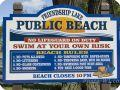 Photo of public beach sign at Friendship Lake.